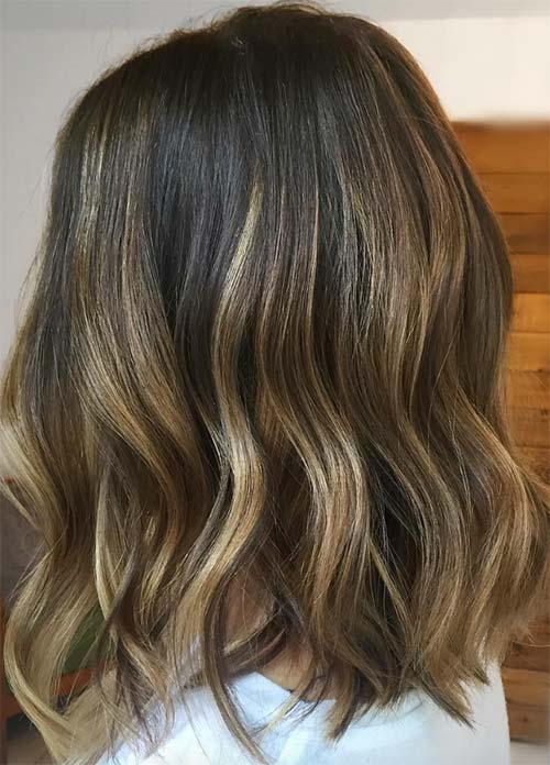 Shimmering blonde on dark brown hair