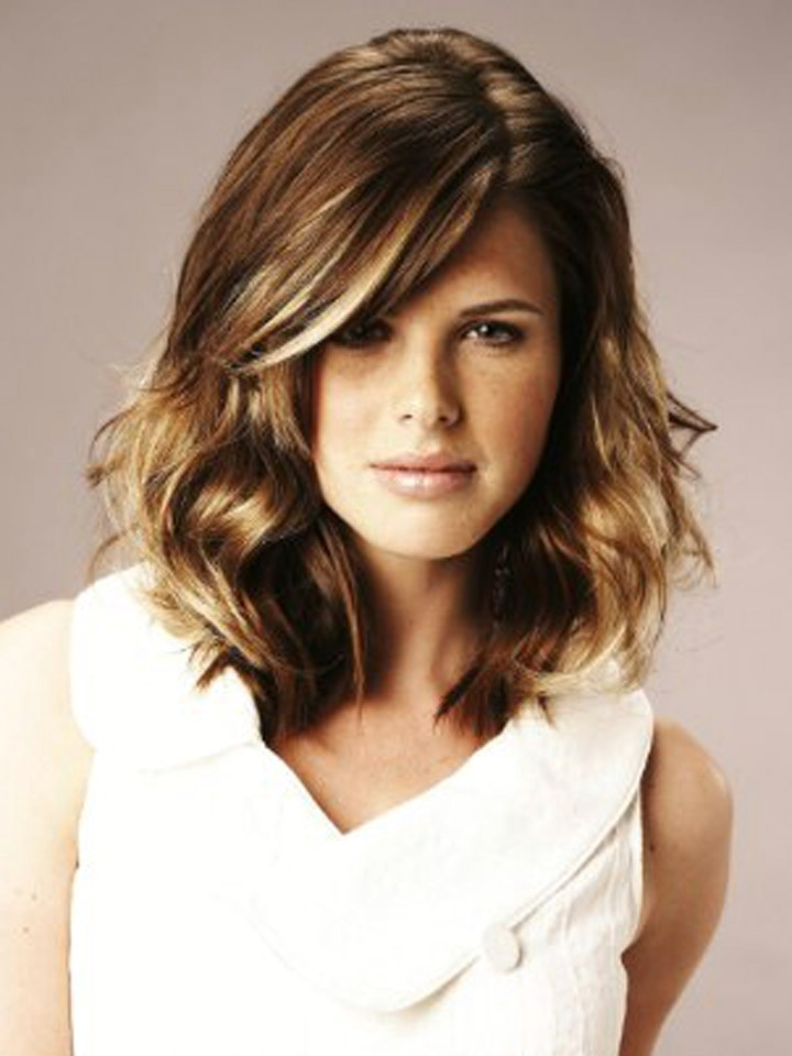 Medium length wavy hairstyles straight bangs with loose curves