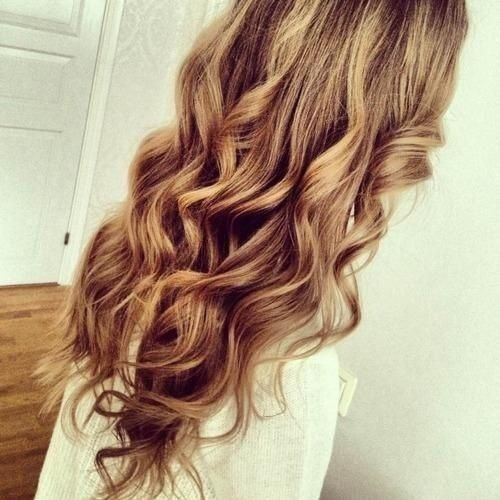 Curly cropped brown hair with light blonde shades