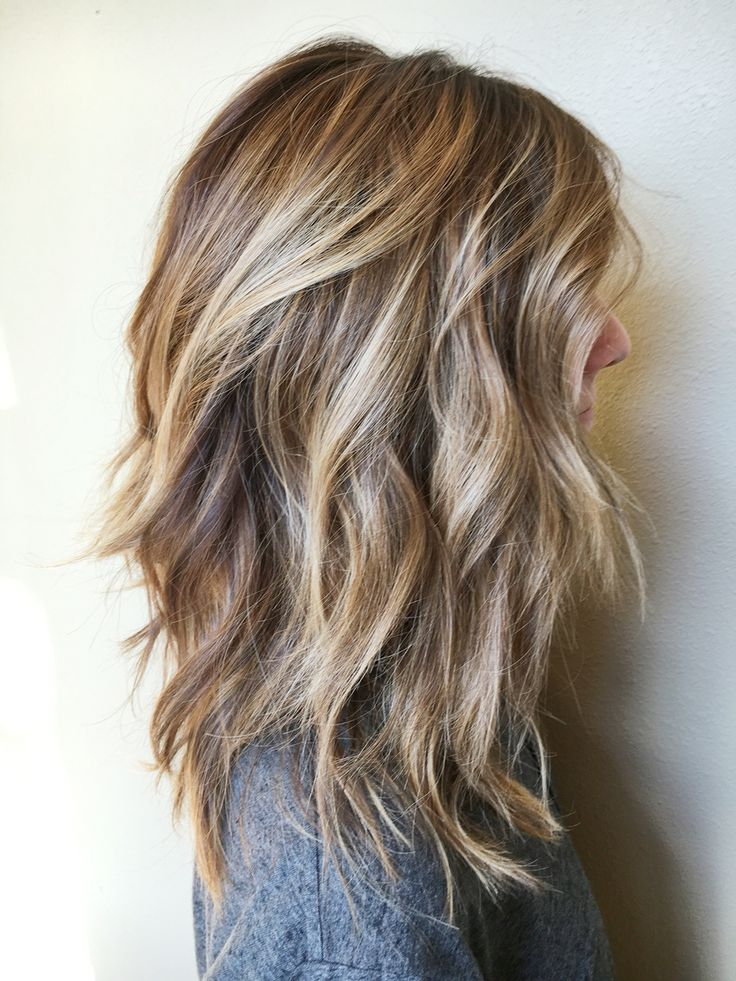 Messy blonde shades on heavy layers