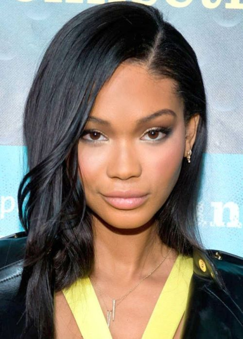 african american long hairstyle Long black side parted look