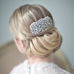 Alluring wedding updo hairstyles twisted updo with a broach