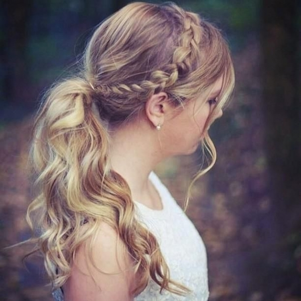 dutch braid hairstyle for woman textured pony tail