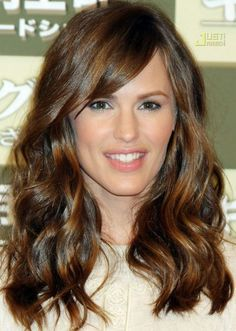 hairstyles for long faces Wavy side parted hairstyle
