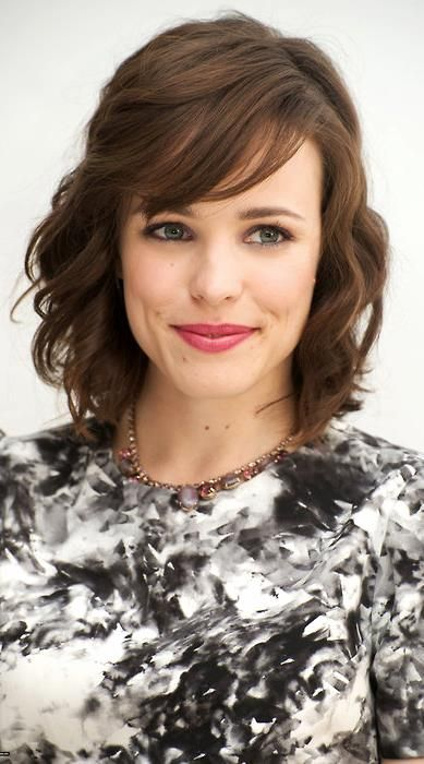 short curly hairstyle with bangs Short curls with long side bangs