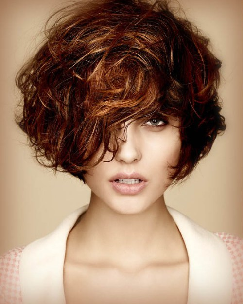 short curly hairstyle with bangs Short tousled with bangs