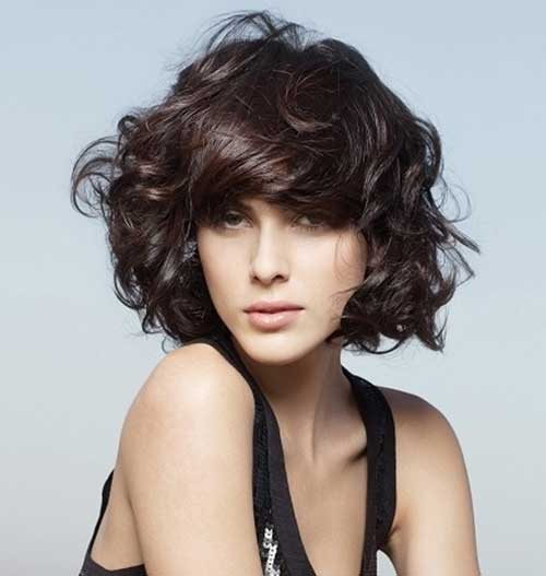 short curly hairstyle with bangs Tired and true with side bangs