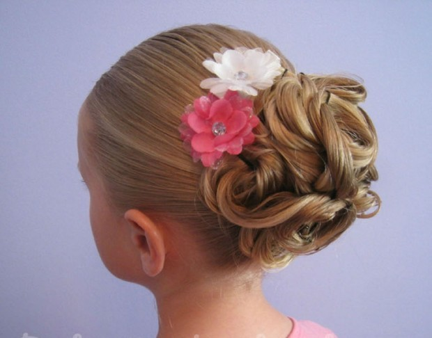 hairstyle for little girl twisted bun with a flower