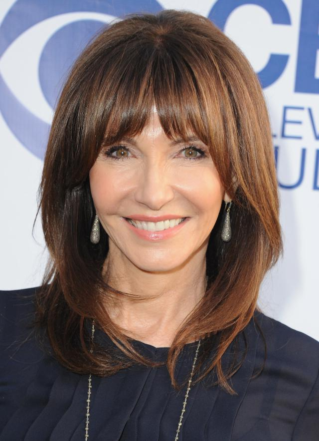 hairstyle for women above 50 Shoulder length cut with bangs