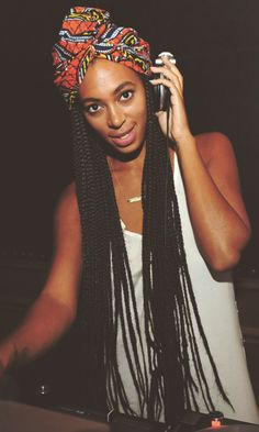images of peppy kinky twist crochet hairstyles Long open hair with red color added stripes