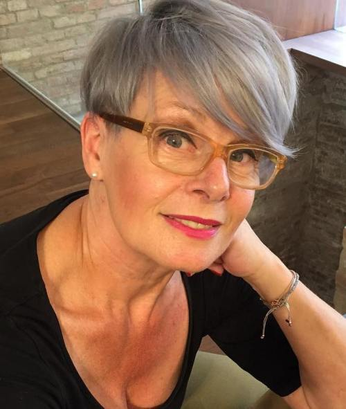 short hairstyle for women over 50 Side parted long pixie