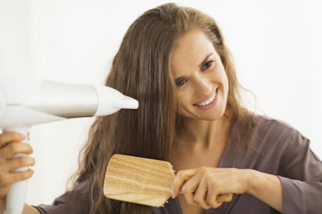 woman-blow-drying-hair-638x425