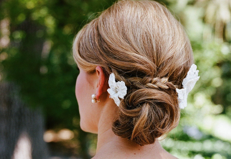 Braids Hairstyle with Flowers Low Twisted Bun hairstyle with flowers