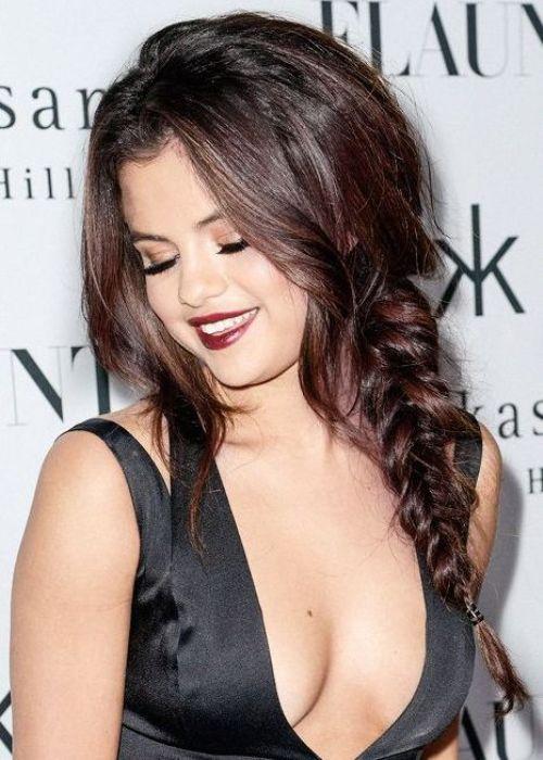 Selena Gomez thick hairstyles French twist