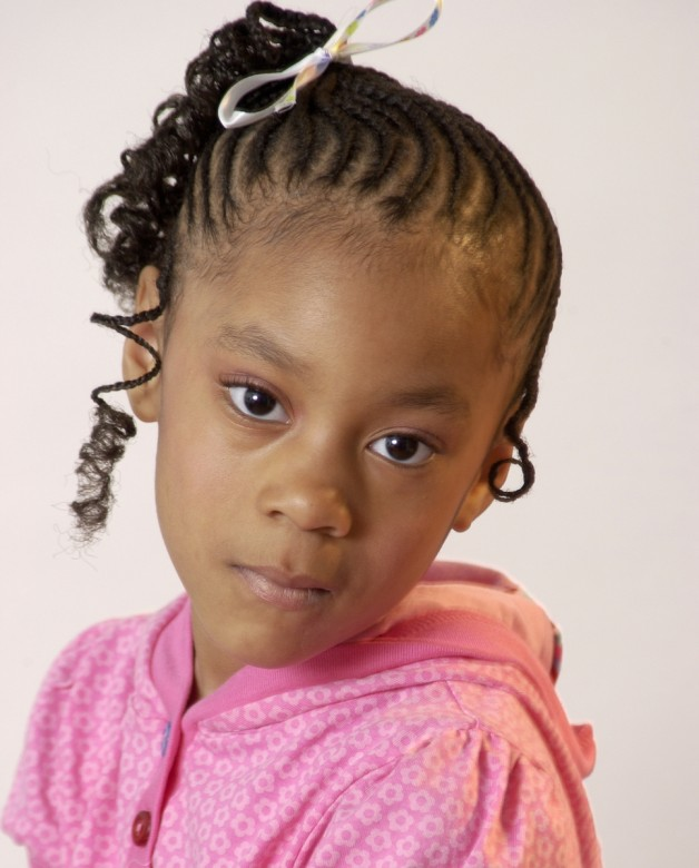Cute Hairstyles for Black Girls high side pony tilk with ribbon