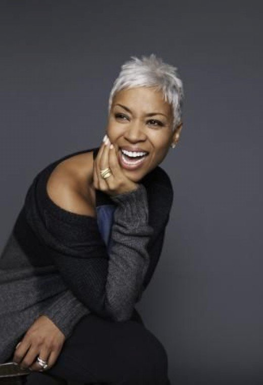 Short hairstyles for black women above 50 black with silver bangs