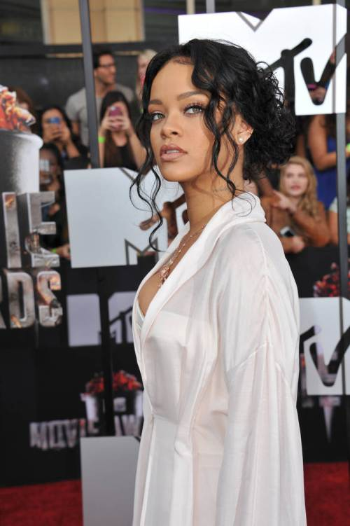long hairstyles for black women Low curly knot