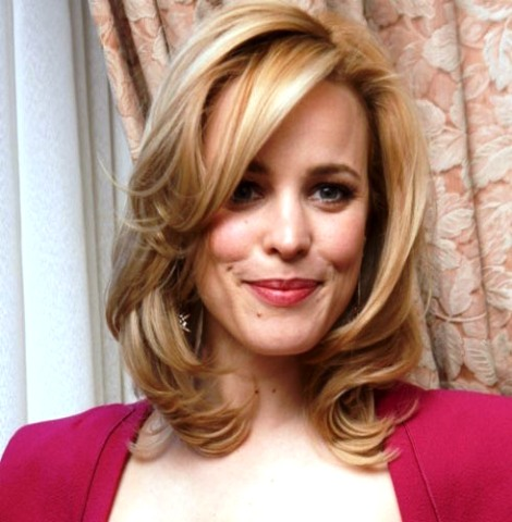 medium hairstyles for women over 40 with fine hair curves with bangs