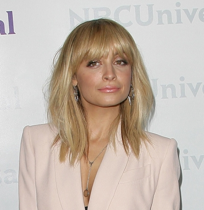 medium hairstyles for women over 40 with fine hair heavy angled bangs