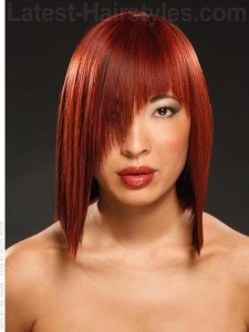 hairstyles-for-girls-with-short-hair-Red bob haircut with long bangs