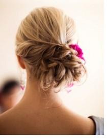 wedding-hairstyles-for-curly-hair- Textured Bun with a Flower