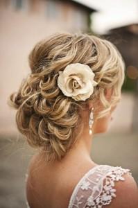 braided-wedding-hairstyle-curled-braided-bun-with-flower